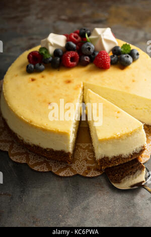 Cheesecake with fresh berries on top - Stock Photo