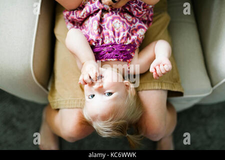 Father playing with baby girl (12-17 months) - Stock Photo