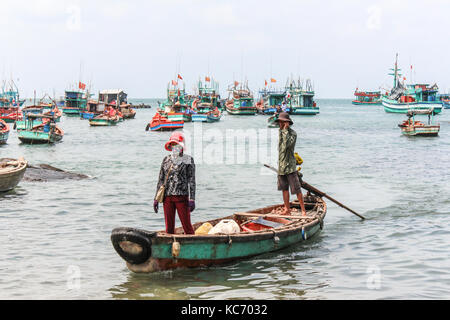 fisher man and woman on wooden boat in Vietnam - Stock Photo