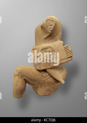 Limestone figure of kneeling Herakles, late 6th or early 5th century B.C - Stock Photo