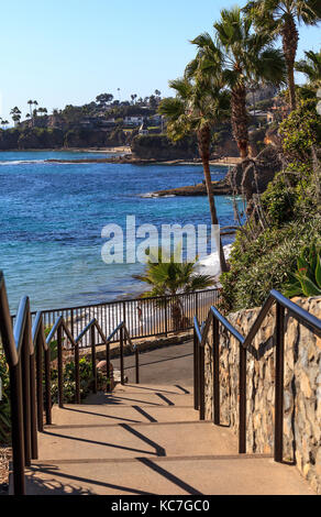 Steps leading down to Heisler Park above the ocean in Laguna Beach, California in fall. - Stock Photo