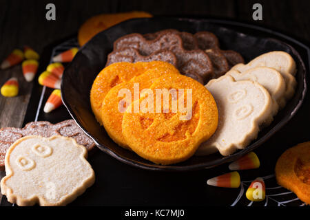 Halloween pumpkin cookies on a plate - Stock Photo