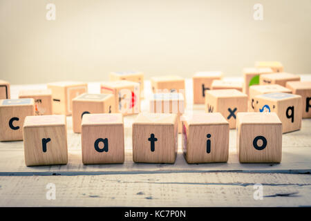 Word ' ratio ' wood Cubic on the wood - Stock Photo