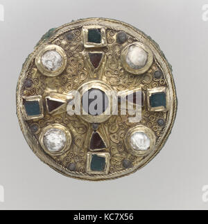 Disk Brooch, late 7th century, Frankish, Gold sheet with copper alloy backing, and inlays of garnet, glass and calcite, - Stock Photo