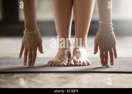 Close up of female hands touching yoga mat - Stock Photo
