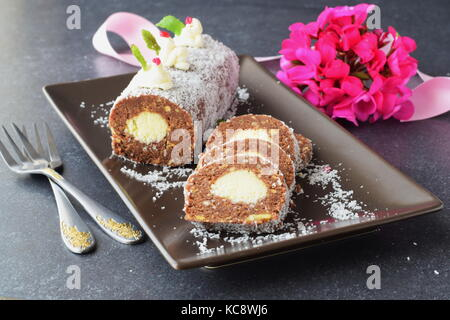 Homemade biscuit roll with coconut filling without baking sliced - Stock Photo