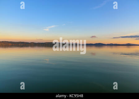Scenic view of the Lake Trasimeno, Umbria, Italy at sunset - Stock Photo