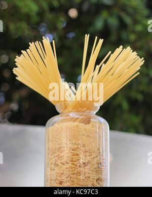 Long spaghetti in the glass jar - Stock Photo