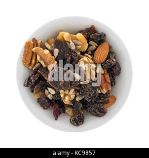 Top view of a serving of beef jerky trail mix in a small bowl isolated on a white background. - Stock Photo