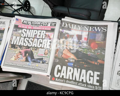 Front pages of New York newspapers on Tuesday, October 3, 2017 report on the shooting by Stephen Paddock in Las - Stock Photo