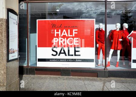 Mid season half price sale shop window uk - Stock Photo