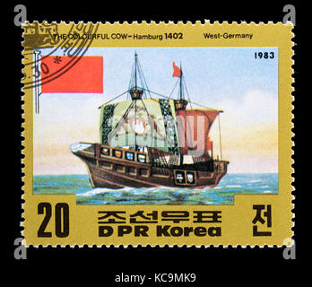 Postage stamp from North Korea depicting old sailing ship The Colourful Cow, Hamburg 1402. - Stock Photo