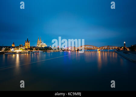 Night View Of St. Martin Church And Cologne Cathedral And Hohenzollern Bridge, Germany. Europe. World Heritage  - Stock Photo