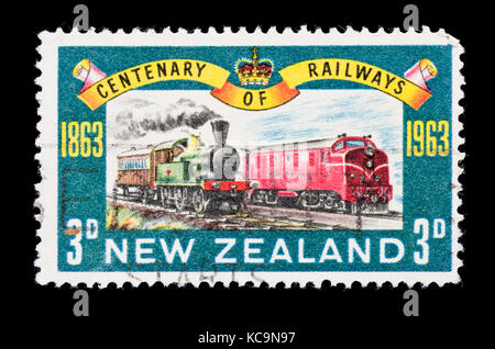 Postage stamp from New Zealand depicting old and new locomotives, for the centennial of New Zealand railroads. - Stock Photo
