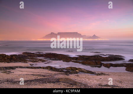 View of Table Mountain from Bloubergstrand at sunset, Cape Town, Western Cape, South Africa - Stock Photo