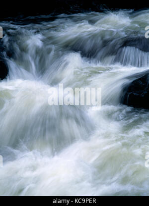 Afon Llugwy, above Swallow Falls, near Betws Y Coed, Conwy, North Wales. River in spate after heavy rain, flowing - Stock Photo