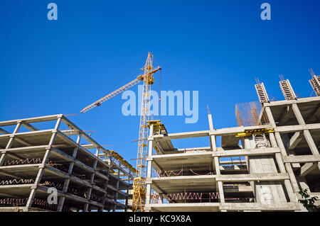 Construction site with cranes with copy space for your text - Stock Photo