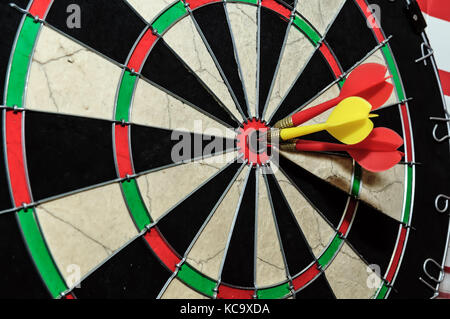 Three darts arrows in the target center in bull's eye. Business goal concept - Stock Photo