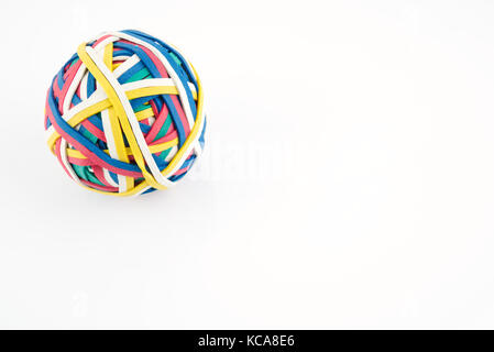 Rubber band ball made from many colourful elastic bands isolated on a white background