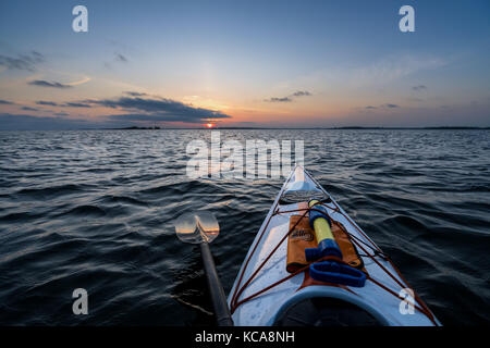 Kayaking at sunset, Baltic Sea in front of Helsinki, Finland, Europe, EU - Stock Photo