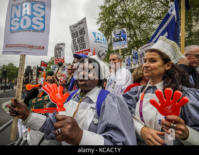 Protesters march and rally over NHS reforms. London, UK. - Stock Photo