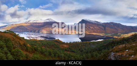 The summits of Slioch and Beinn a Mhuinidh over Loch Maree in the Scottish Highlands, Scotland, UK. - Stock Photo