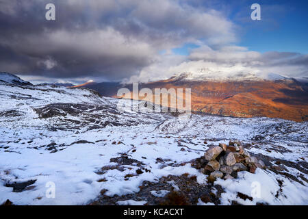 The summit of Slioch over Loch Maree in the Scottish Highlands, Scotland, UK. - Stock Photo