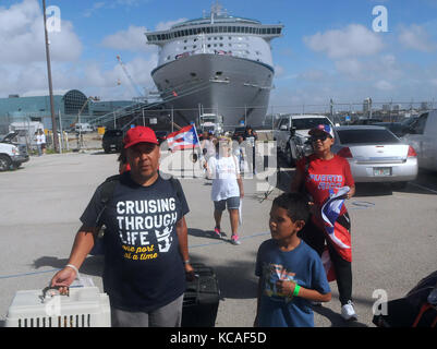 Fort Lauderdale, Florida, USA. 03rd Oct, 2017. The Rivera family, victims of Hurricane Maria, arrive at Port Everglades - Stock Photo