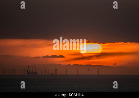 Eastbourne, East Sussex, UK. 3rd Oct, 2017. UK Weather. Sunset over the Rampion offshore wind farm in the English - Stock Photo