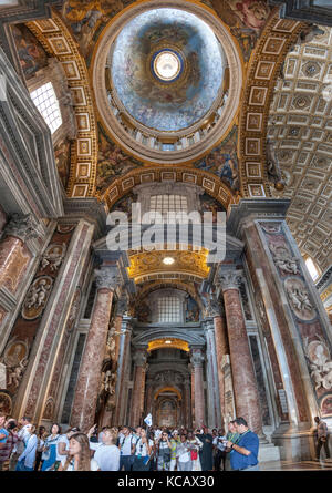 Interior and ceilings of St Peter's Basilica in the Vatican City in Rome. - Stock Photo