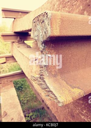 Stolen rail. Detail of autogen torch  cut rail rod on concrete sleeper. Repair of tramway.  Installation of new - Stock Photo