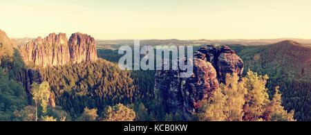 Sharp Schramsteine and Falkenstein rocks in panoramic view. Rocks in the Elbe Sandstone Mountains park, Saxony, - Stock Photo
