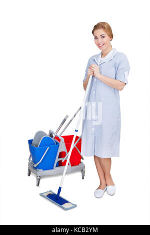 Young Female Janitor Cleaning Floor Using Mop On White Background - Stock Photo