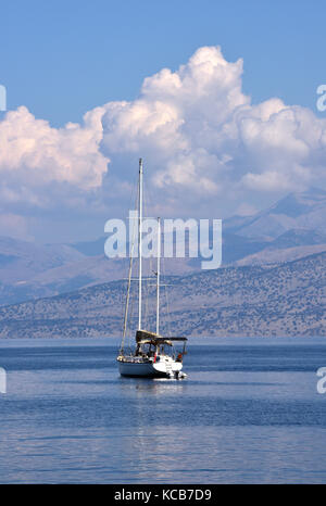 A large luxury sailing yacht wit two masts in the deep blue Ionian or Mediterranean Sea off of the coast of Albania - Stock Photo
