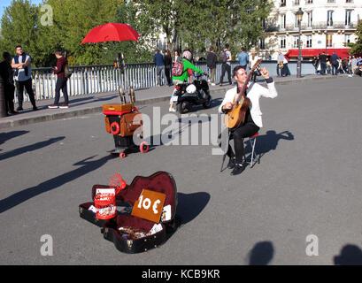 Tom War guitarist at Pont Saint-Louis, bridge, Seine river, Paris, France; Europe - Stock Photo