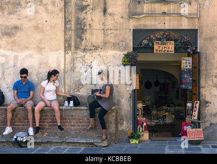Siena, Siena Province, Tuscany, Italy.  Street scene in the old town. The historic centre of Siena is a UNESCO World - Stock Photo