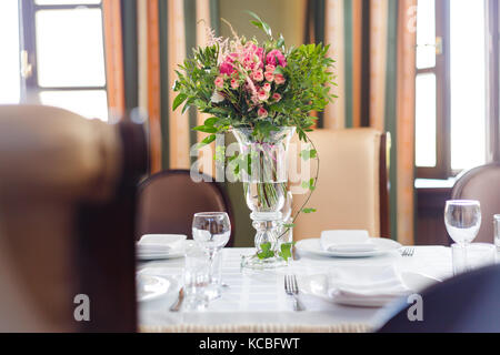 Flora on the holiday table. Bouquet of wildflowers - Stock Photo