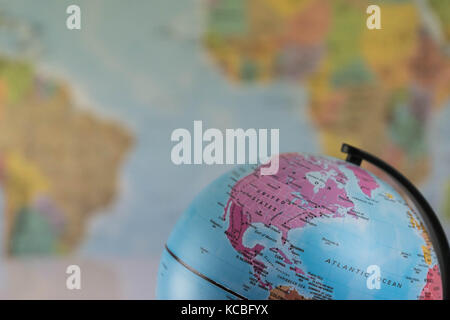 The United States of America on the map globe with blurred map as background - Stock Photo