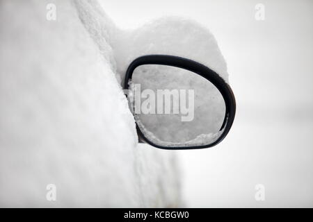Car rearview mirror under snow in winter - Stock Photo
