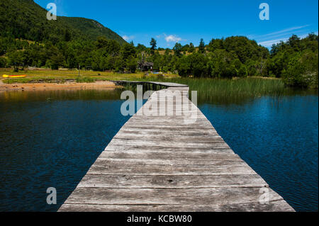 Wooden boat pier on Lago Tinquilco in the Huerquehue, southern Chile - Stock Photo