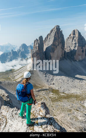 Trekker at the summit of the Patternkofel, Northern walls of the Three Peaks, Sesto Dolomites, South Tyrol, Trentino - Stock Photo