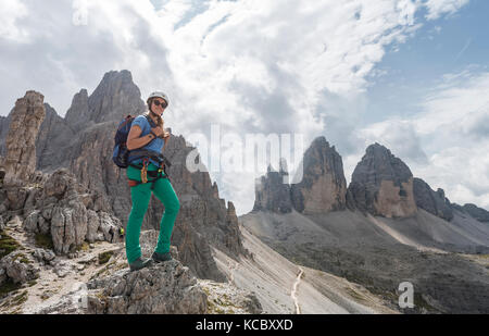 Hiker on the via ferrata to Patternkofel, Northern walls of the Three Peaks, Sesto Dolomites, South Tyrol, Trentino - Stock Photo