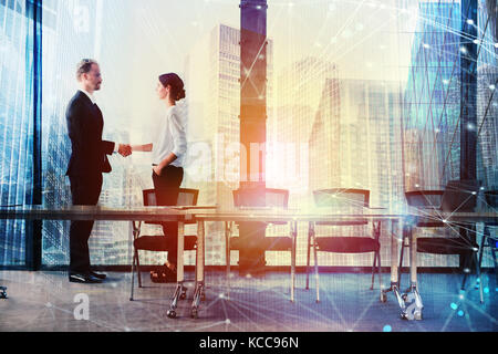 Handshake of two businessperson in office concept of partnership and teamwork - Stock Photo