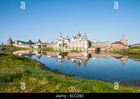 View on Solovetsky Monastery with reflection in water, Russia - Stock Photo