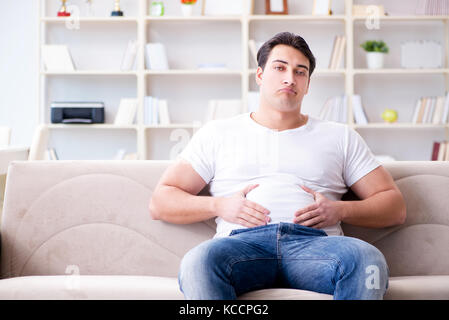 Man suffering from sick stomach and vomiting - Stock Photo