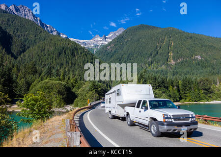 Truck with camping trailer on North Cascades Highway Route 20 in North Cascades National Park in Northwest Washington - Stock Photo