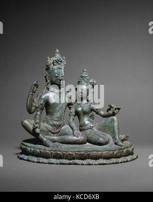 Shiva Seated with Parvati, Thakuri period, 11th century, Nepal (Kathmandu Valley), Copper alloy, H. 10 1/4 in. (26 - Stock Photo
