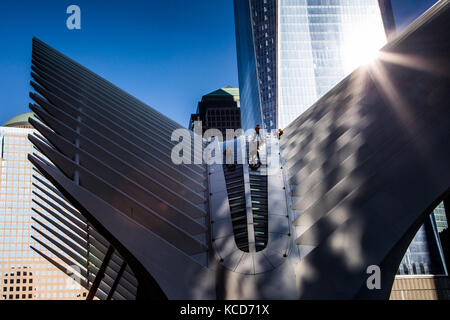Window washers on the Oculus at World Trade Center, downtown Manhattan, New York - Stock Photo