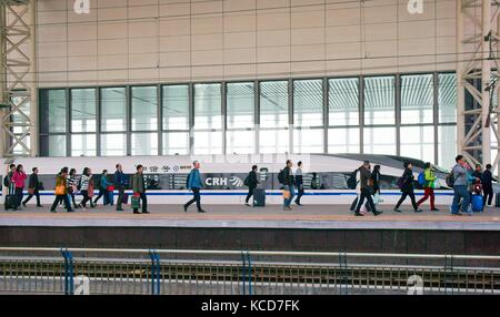 Chinese high speed electric bullet train on the Beijing Shanghai rail line at Tianjin South Railway Station, Tianjin - Stock Photo