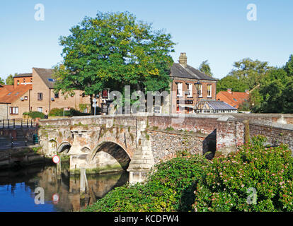 A view of the historic Bishop Bridge over the River Wensum in Norwich, Norfolk, England, United Kingdom. - Stock Photo